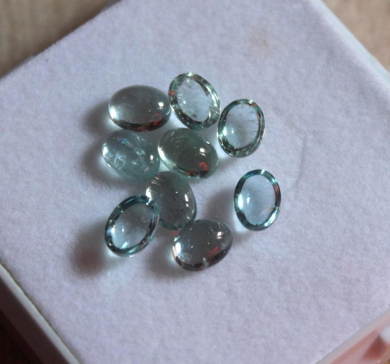 Natural Aquamarine Cabochon 7.23 Carat 7x5 MM Oval Shape 9 Pieces Lot Sky Blue Color Very Good Quality