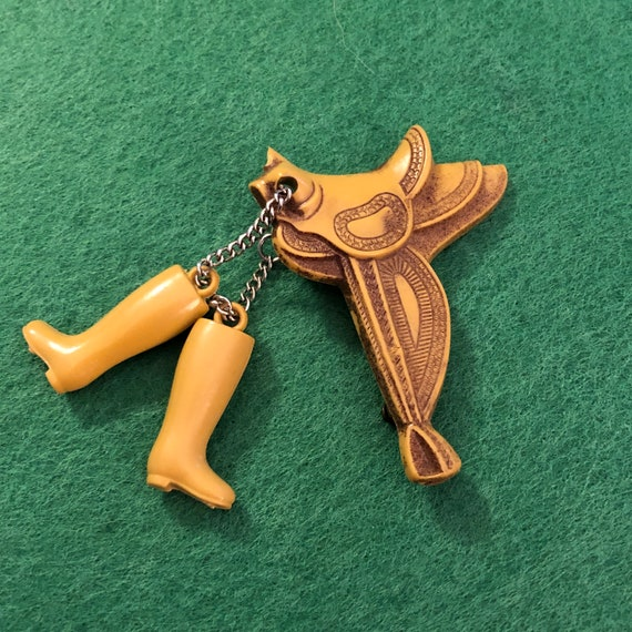 1930s Celluloid Western Saddle & Boots Pin - image 1