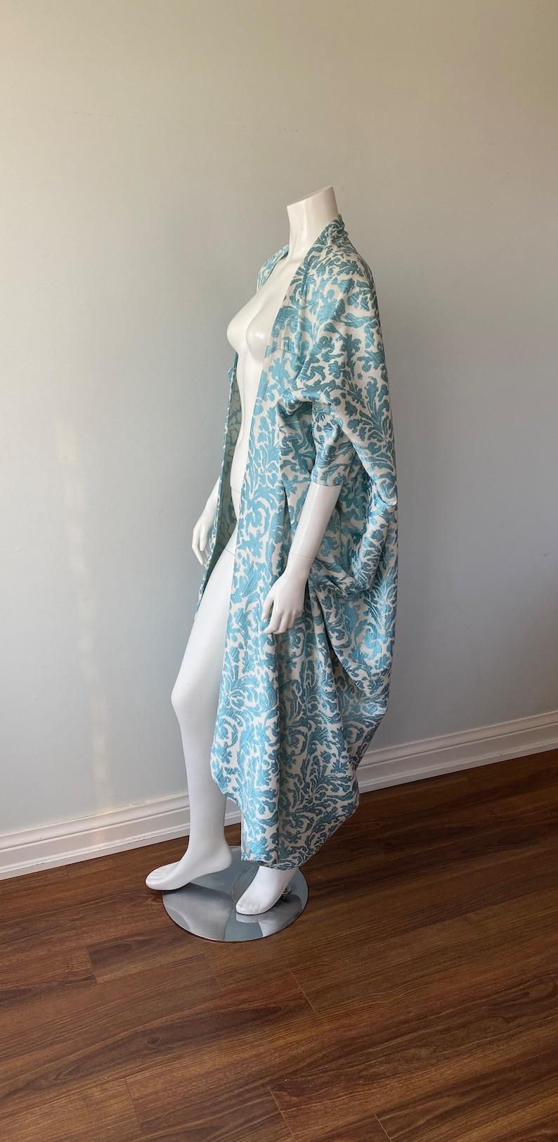 1920s Coats, Furs, Jackets and Capes History     Read the full title    1920s Style Kikoon Kimono Coat Duster Evening Kikoon Kimono Duster Kikoon $220.00 AT vintagedancer.com