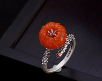 Beautiful 105 carat plum blossom agate oval drilled pendant measuring 45 by 35 by 8 mm.