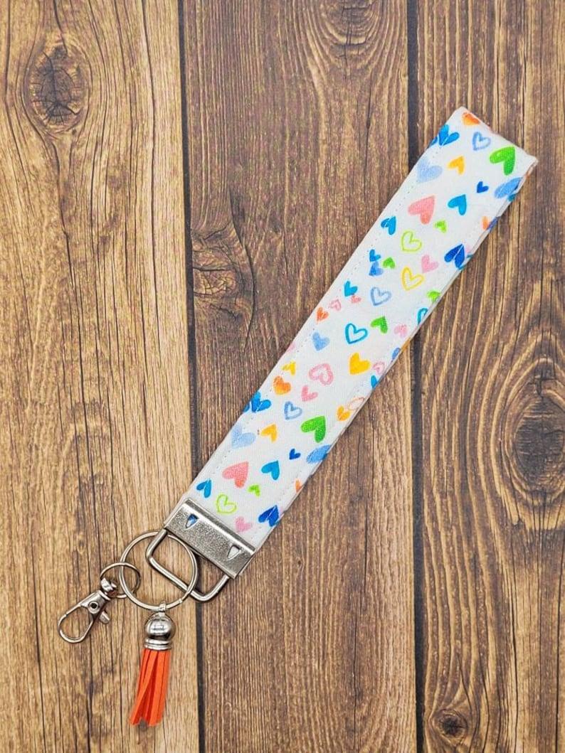 Heart Key Fob Wristlet with Tassel Rainbow Wrist Strap Hearts Keychain with clip Car Accessories for Women Key Lanyard Fabric Wristlet