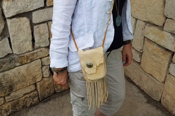 Handmade leather purse with woven detail