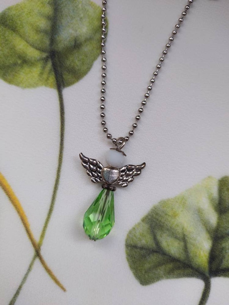 Green-white crystal angel parure and natural stones Colored wings