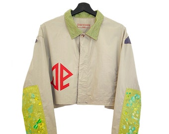 Kalafaker (L) Vintage 90s Custom | Crop top jacket, windbreaker, long sleeves, button closure, inner pocket, text collage, paint.