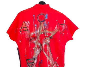 Adidas (M) Vintage 90s Custom | Windbreaker short sleeve, hood, pockets, zipper closure, paint, text patch.
