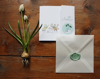 Wedding or event announcement with cottages and plants. Transparent matte envelope and sealing wax closing with botanical stamp