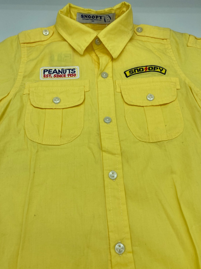 Snoopy Pilot Shirt in Yellow toddler XS in cotton never been worn Snoopy 50th anniversary