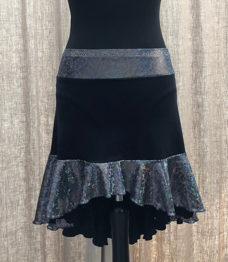 Elegant fishtail style black /& silver ice dance skirt with integral pants and hem edged in metallic thread  Adult size 10