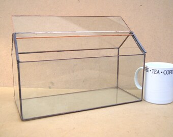 Closed window sill terrarium, Made from reclycled glass.
