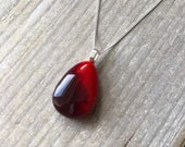 Red teardrop shaped pendant, fused glass
