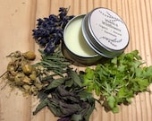 Headache and migraine balm remedy with feverfew, rosemary, peppermint, chamomile and lavender oil - vegan, natural, organic.