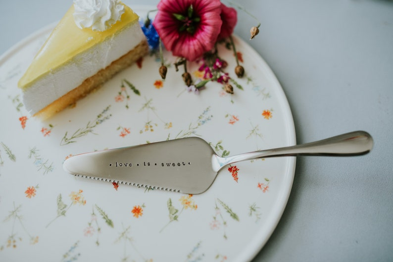 Cake shovel server in silver color with hand stamped text  love is sweet