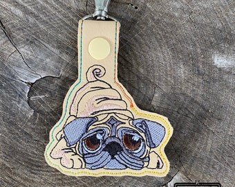 ITH Pug keyfob machine embroidery design. Sad cute pug embroidery. Keyfob, snap tab in the hoop embroidery design. For the hoop 4x4