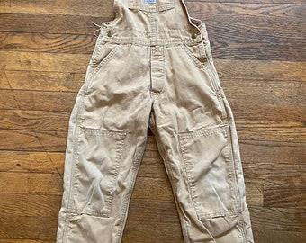 Vintage 80's-90's Carhartt overalls for smaller child. Fleece lined. Adjustable suspenders. Super durable. Made in the USA.