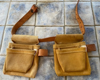 American Leather Craft inc. leather tool pouches. The belt is short in length perhaps for a kid. Pouches are removable. Made in the USA