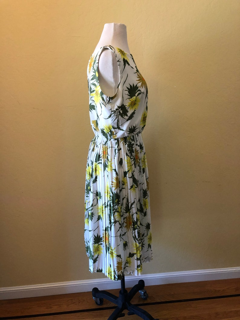 Sleeveless Bold Yellow Size 6-8 1960s Spring Flowers Dress Gold and Green Floral Design on White Background Fun!