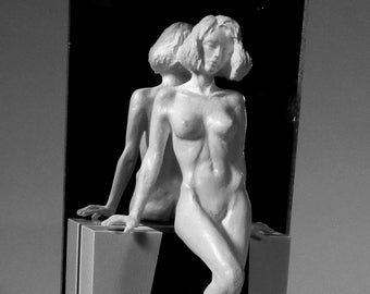 Sensual Leah leaning and sitting on a stool. As with the others, her back is shown by means of a mirror.