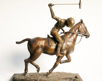 Charge is a 12 Inch high bronze statue of a polo-player on one of his ponies, (a thoroughbred horse) ready to Strike the ball .....