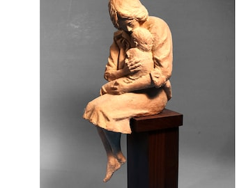 CARING depicts a mother caring and comforting her young child.  This is the perfect gift for a a wedding anniversary or Mother's day.