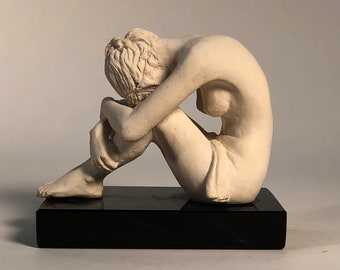Anne Meditating: A part of the Series of Anne, It is a small decorative nude figure, in solitude, with a smooth porcelain-like texture.