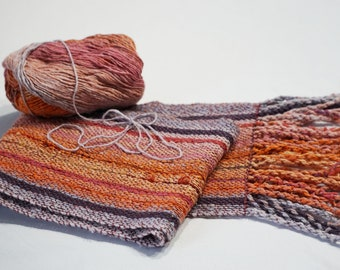 Handwoven silk blend scarf in soft shades of orange, pink, and purple