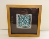Abstract textured painting in a box frame