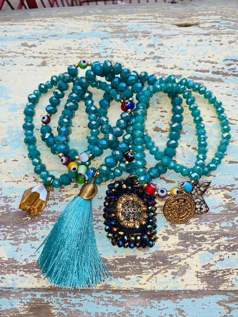 St Benedict Stackable Elastic Semiprecious Turquoise Bead Bracelet 7 Multi-Layered Semanario Evil Eye Beads Tassel and Charms.