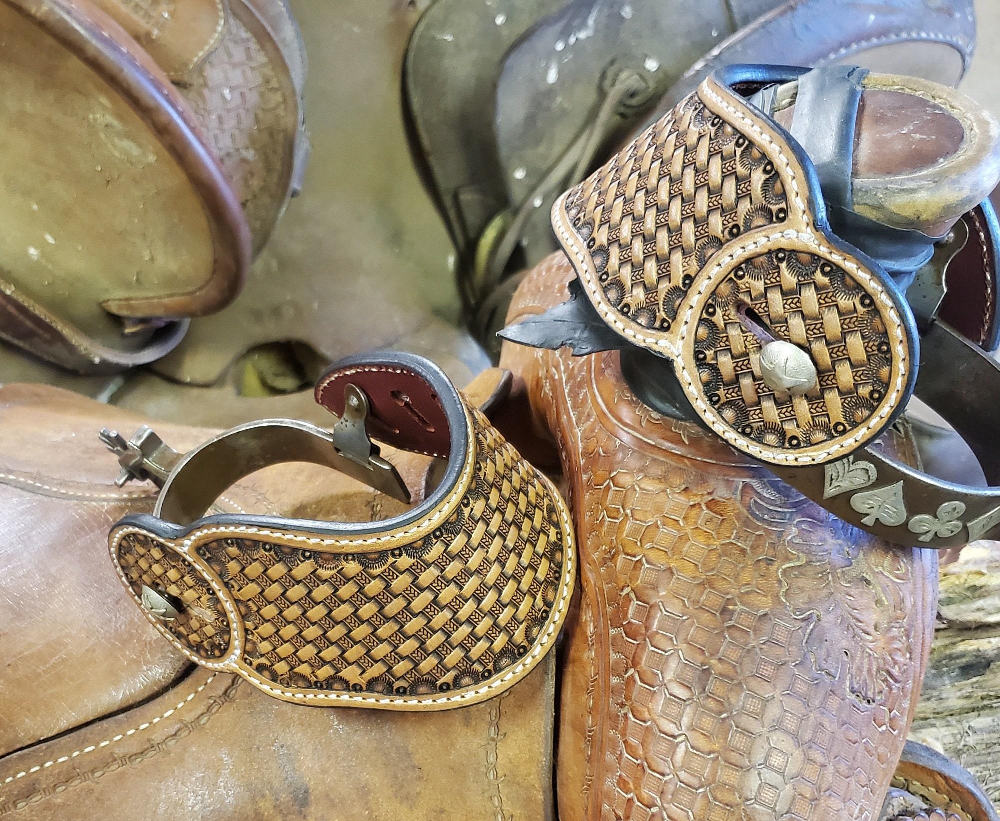 Basket weave stamped dove wing spur straps.