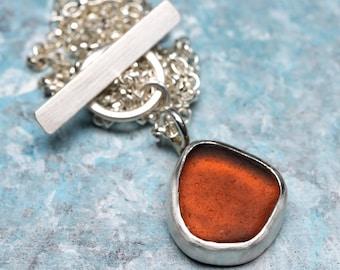 Dark amber sea glass silver necklace
