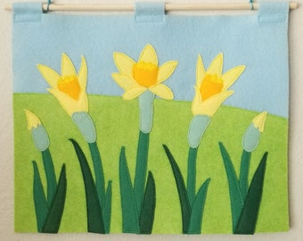 Spring Daffodil Wall Hanging - Handmade Felt Art Featuring Vivid Green and Yellow Daffodils Against a Mottled Blue Sky & Soft Green Grass