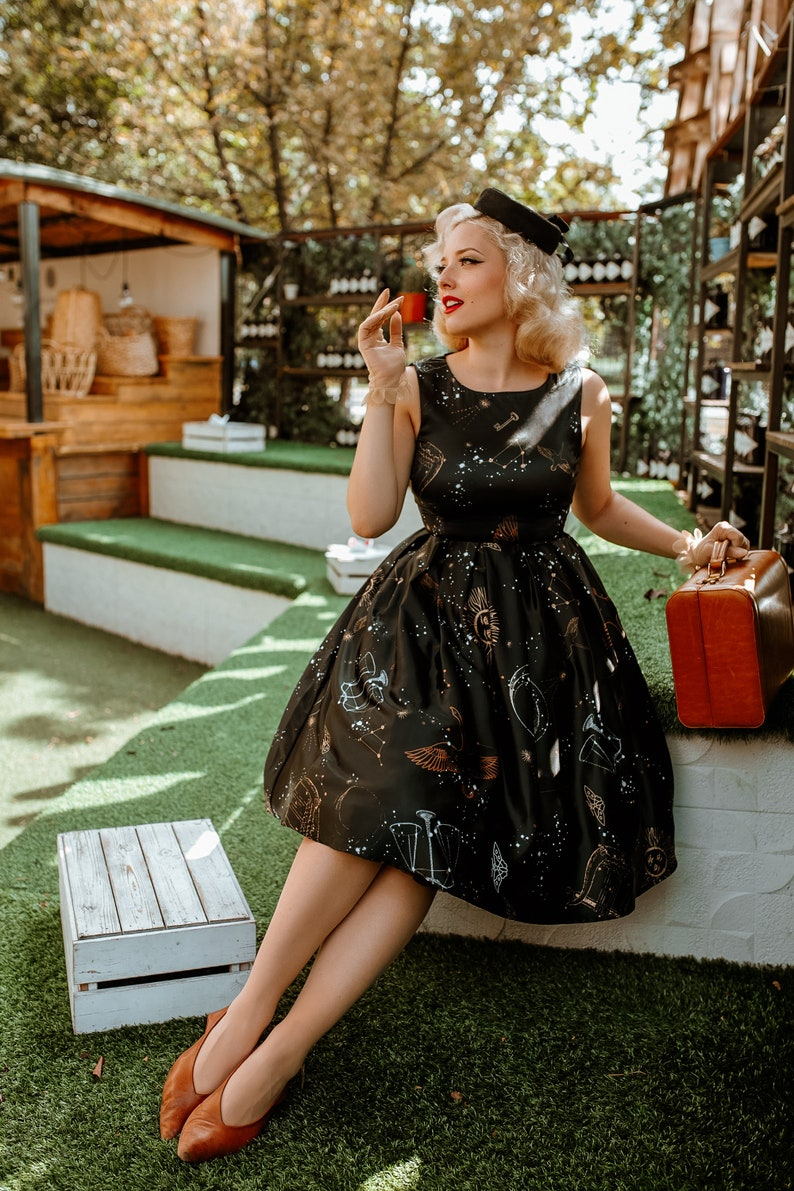 1950s Style Clothing & Fashion Annie Vintage Inspired Swing Dress in Black Astronomy Print $56.67 AT vintagedancer.com