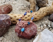Hand-made hammered copper and blue glass bracelet, one of a kind.