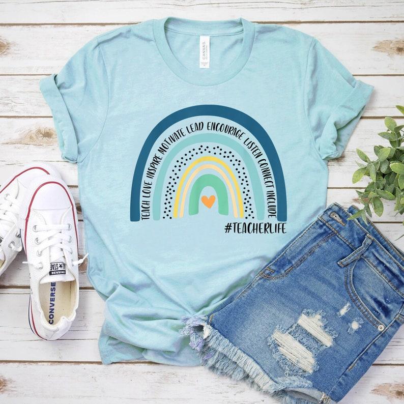 Rainbow Teacher T-Shirt Teach Love Inspire Motivate Lead Bella Light Blue