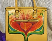 Beautiful, brand new, yellow leather hand bag, hand-painted with a bold red floral motif