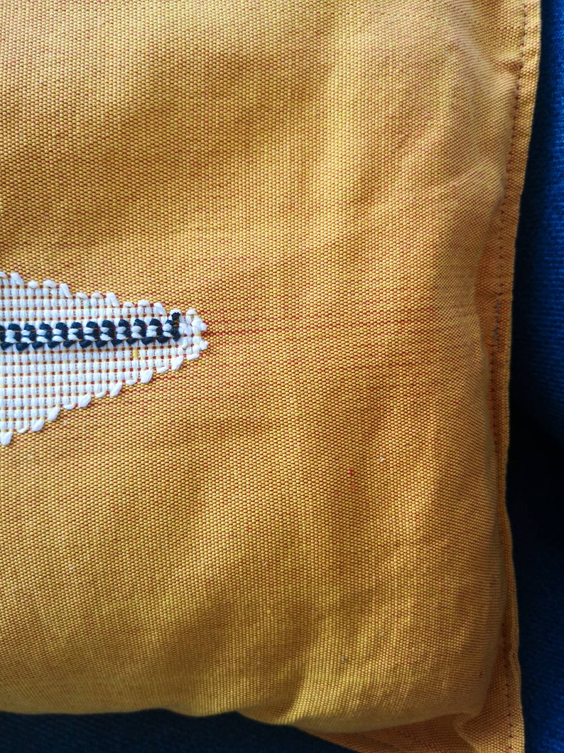 Hand embroidered cushion in Kente fabric