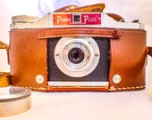 Film Tested Purma Plus Camera with Leather Case. Plus The Purma Camera Book.