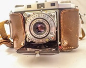Zeiss Ikon Contina II, Rangefinder. 35mm Film Folding Camera in good condition with case.