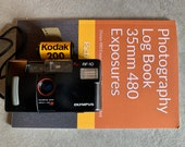 Olympus AF-10 Film 35mm Camera with Kodak Film, Log Book and new soft case. Plus Instruction Manual. Film Tested.
