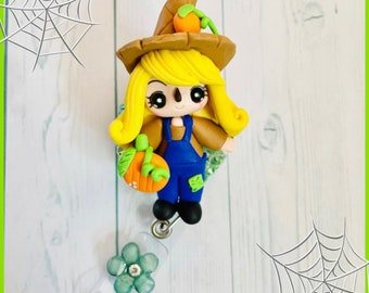 Adorable blonde scarecrow clay doll badge reel