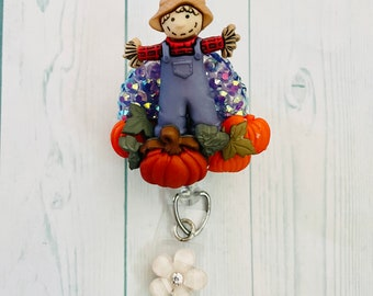 Cute fall themed scarecrow pumpkin patch badge reel