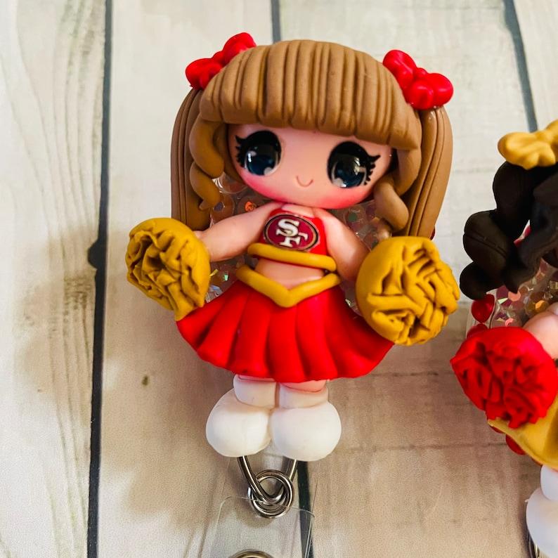 San Francisco 49ers cheerleader clay doll badge reel