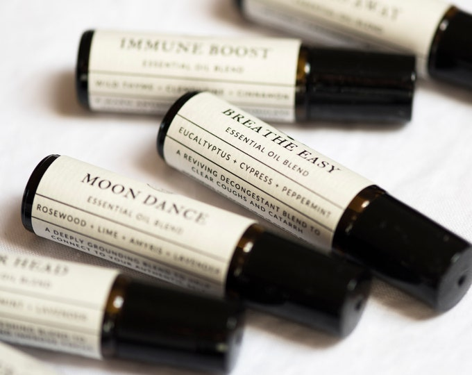 Featured listing image: Roll-on aromatherapy blends with pure essential oils for stress, headaches, sleep issues, meditation, fatigue and hormonal imbalance.