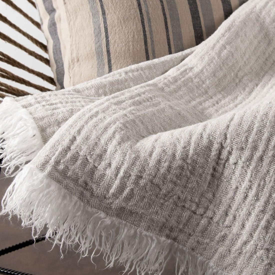 Light grey handmade patterned linen blanket