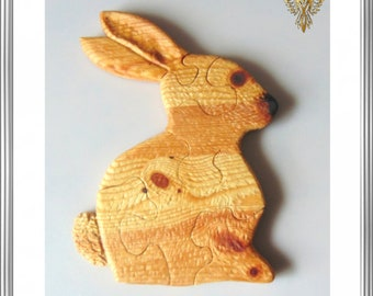 Easter bunny as wooden puzzle in six parts.