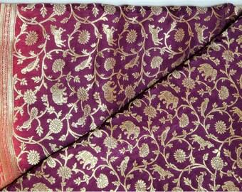 Banaras Georgette Pure Silk Saree: Bright Plum with Coral Combination.  Full Jungle Theme Woven Body in Gold Jari
