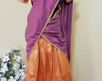 Designer Half Saree: Peach Self Border Skirt   Mauve Voni   Contrast Blue Blouse