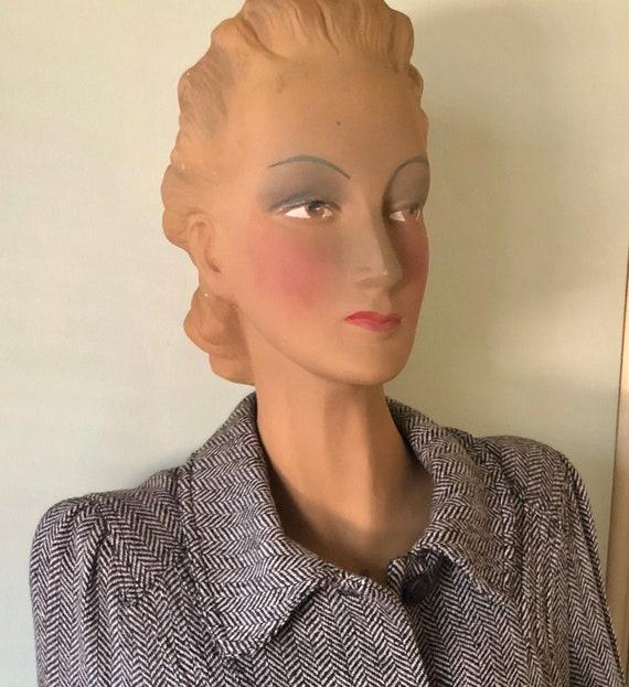 Vintage herringbone jacket in 40s style.
