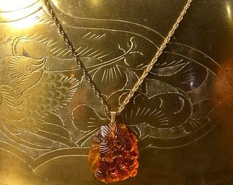 Vintage carved flower amber pendant