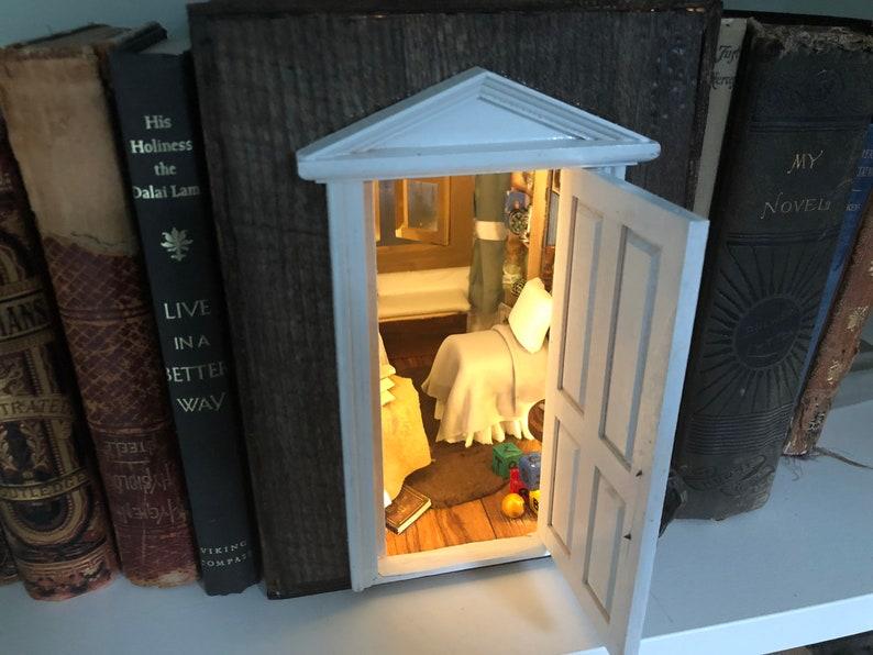 Off to Neverland  Peter pan book nook book shelf insert image 0