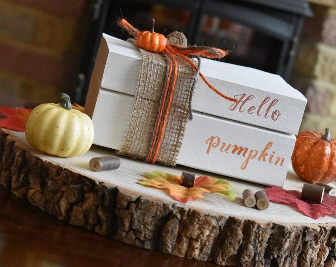 Hello pumpkin, autumn stamped books, autumn decor, fall decor, pumpkin decor, painted books, fall book stack, decorative books